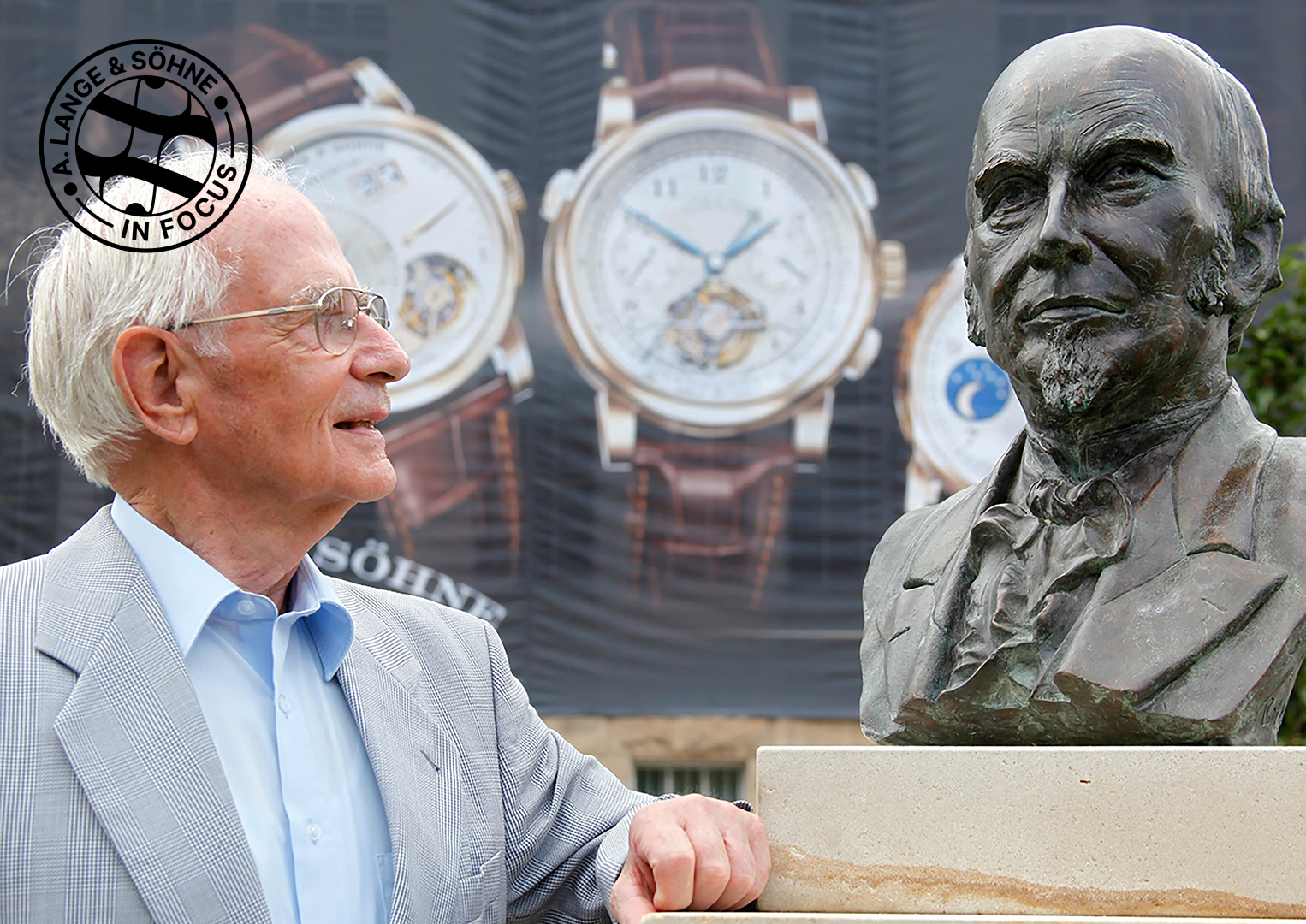 The late Walter Lange stands beside a bronze bust of his great-grandfather Ferdinand Adolph
