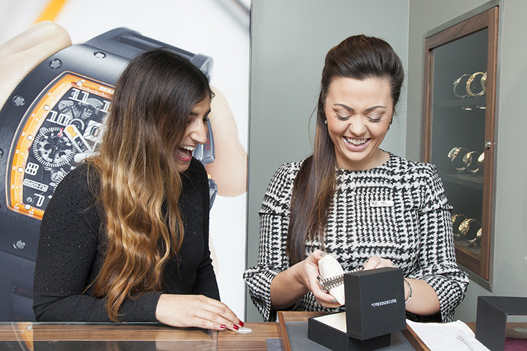 Amy Falco presents the Rolex Datejust to Dr. Rupal Patel